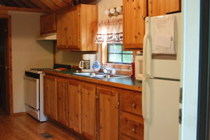 Cedar-Lodge-kitchen-full-fridge-stovetop-oven